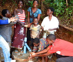 Smiles at a new pump in Juma