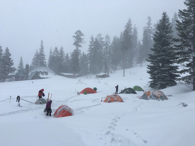 Setting up camp in snow