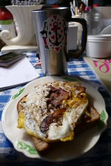 bacon and egg sandwich with coffee