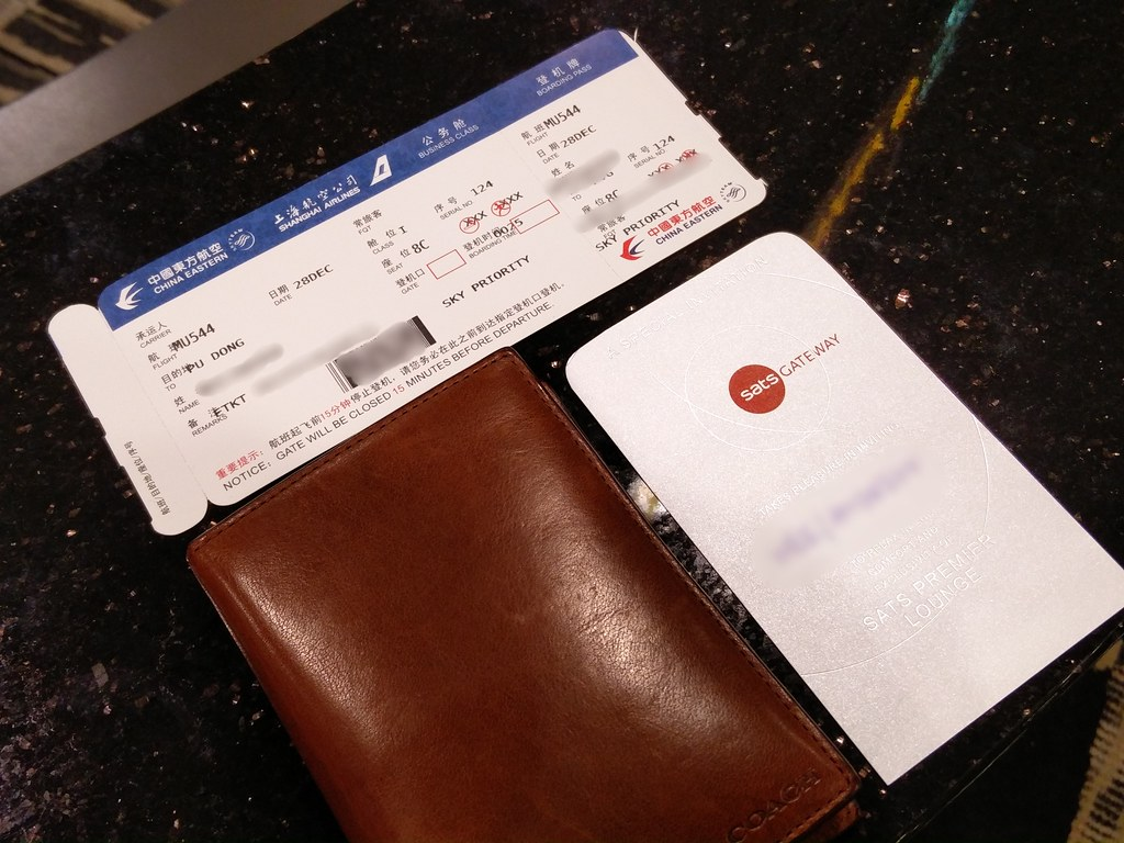 Boarding pass and lounge invite