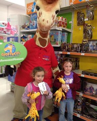 The girls helped #geoffrey celebrate his #birthday with a story and a #stuffedtoy #giraffe. Thank you @toysrus