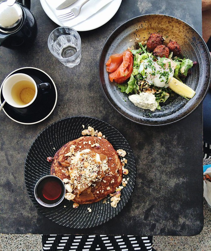 Creatures of habit. Another shared brunch of teff pancakes w syrup on the side, and cured salmon/fritters/60-60 eggs ??