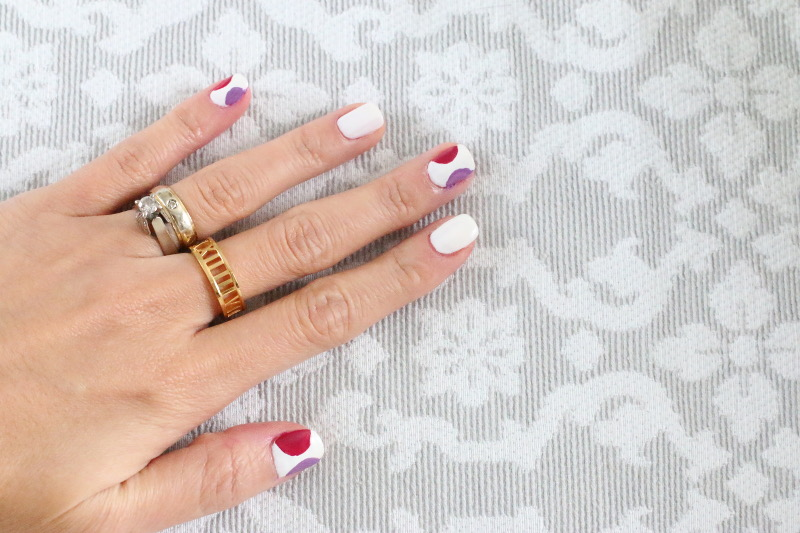 white nail polish half circle, dots