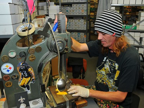 Highland Mint employee James Moore numbering Super Bowl 50 coins