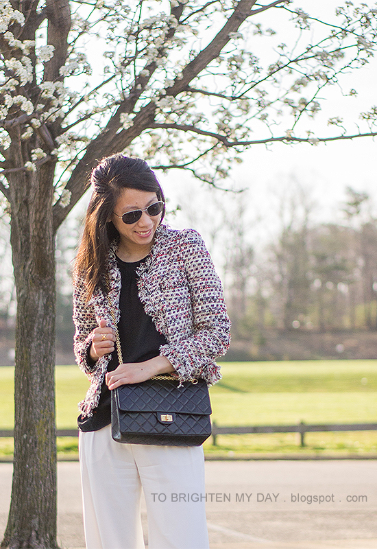 tweed jacket, white trousers, black crossbody bag