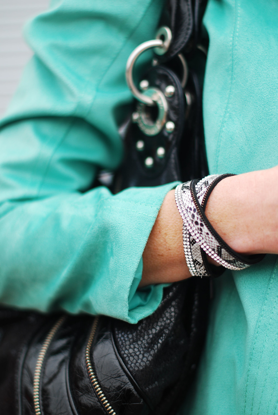 Snake print & diamante wrap bracelet, black slouch bag, mint biker jacket | Not Dressed As Lamb