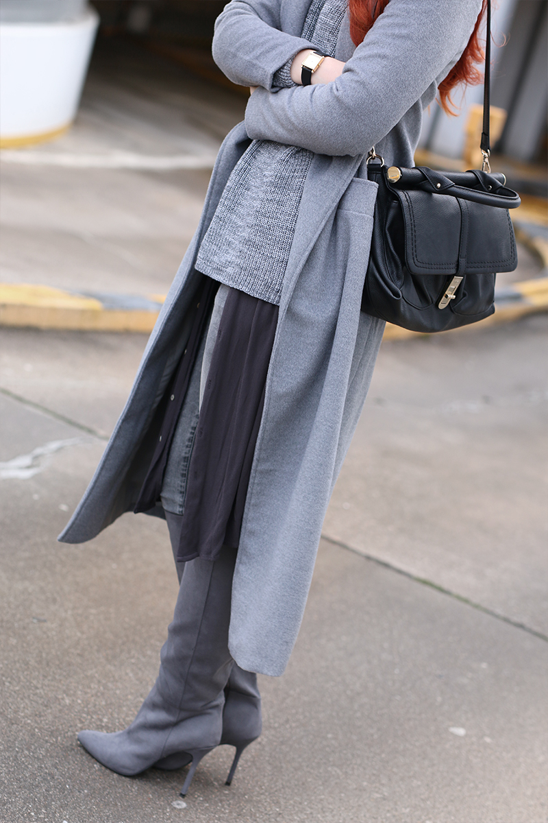 All grey outfit with hat and long grey coat