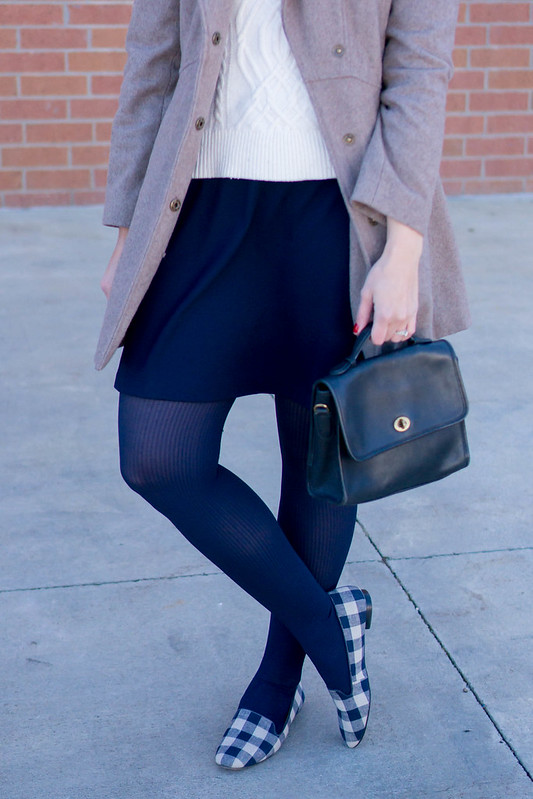 white cable knit sweater + navy skirt + gingham print shoes + wool coat; winter work outfit | Style On Target
