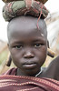 Portrait of a child from Mursi tribe with gauged piercings.
