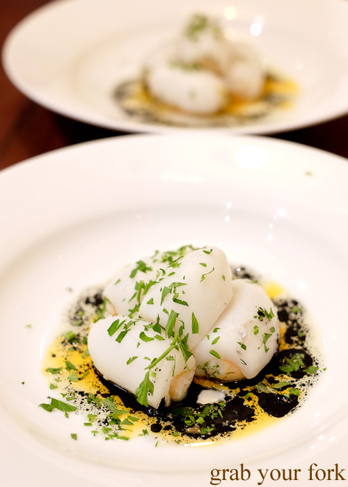 Cuttlefish gnocchi with squid ink and prawn oil