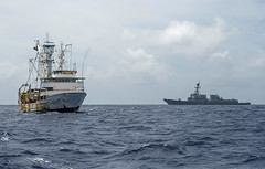 USS William P. Lawrence (DDG 110) sits in the vicnicty of a fishing vessel while support a boarding and inspection as part of the Oceania Maritime Security Initiative. (U.S. Navy/MC3 Emiline L. M. Senn)