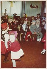 Small children in Halloween costumes at school