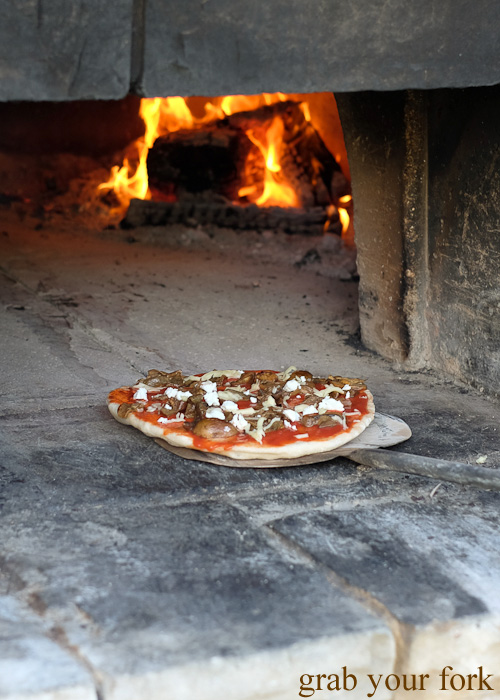 Cooking pizza in the wood fire oven at Primo Estate in McLaren Vale, South Australia