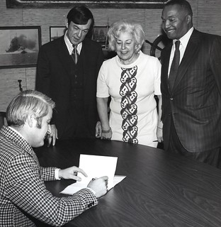 Mayor Uhlman signing legislation with Councilmembers Tim Hill(?), Jeanette Williams, and Sam Smith, 1972