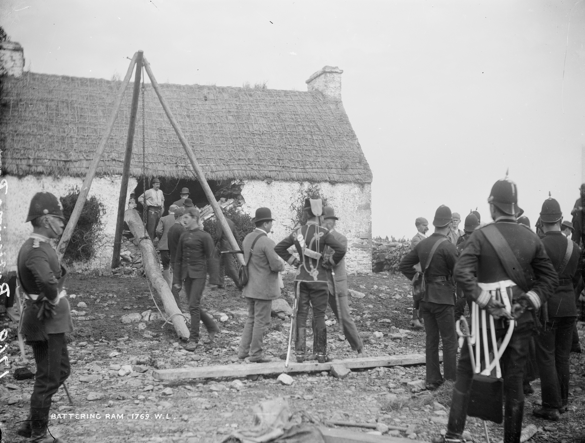T.Birmingham's house, Moyasta, Co.Clare with Battering Ram and soldiers outside