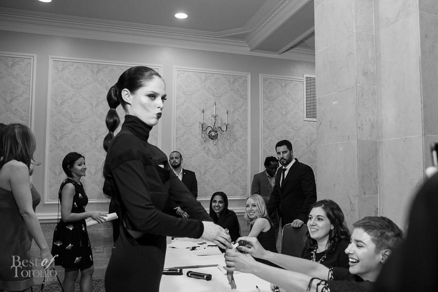 Coco Rocha going back to the table to get her stamp for the CAFA after party
