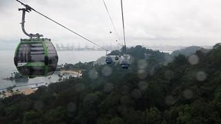 Siloso Beach की छवि. trees sea beach wet rain singapore sentosa cablecars