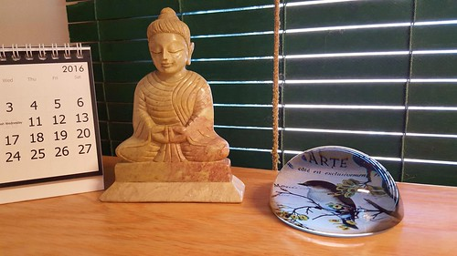 Buddha and bird paperweight