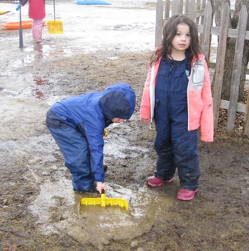 shoveling mud