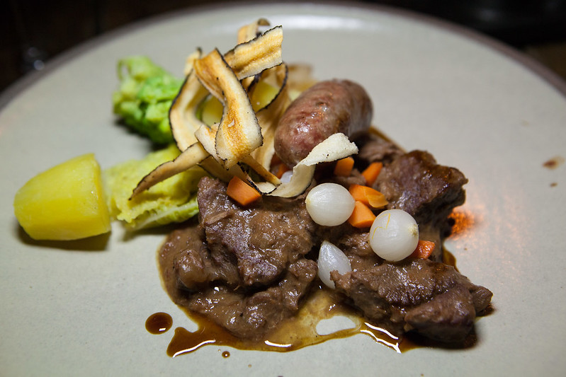 Wild boar stew, Bruut Gajes beer with boar and caraway sausage, salsify, green cabbage, romanesco, Nicola potato