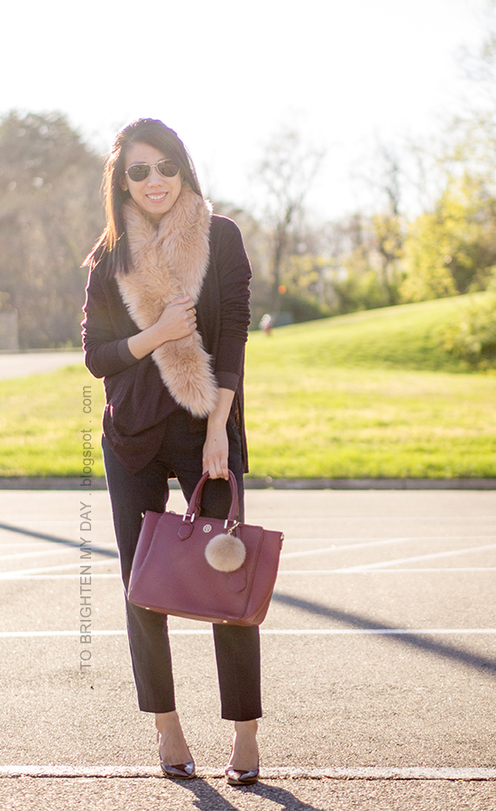 faux fur scarf, plum sweater, navy pants, burgundy pumps, burgundy tote with faux fur keychain