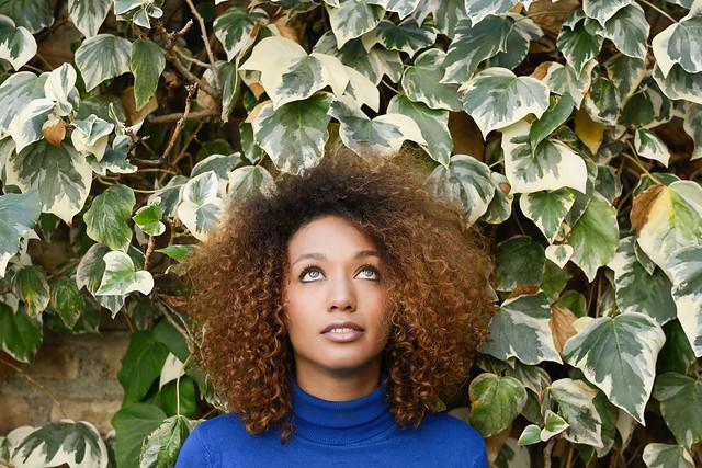 Afro Girl against green leaves