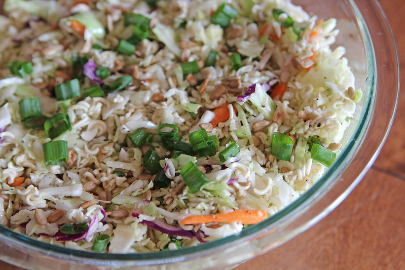 Asian Coleslaw with Ramen Noodles. Also known as Fumi salad, this Asian coleslaw has a flavorful homemade dressing and is served with crunchy ramen noodles. A potluck favourite!