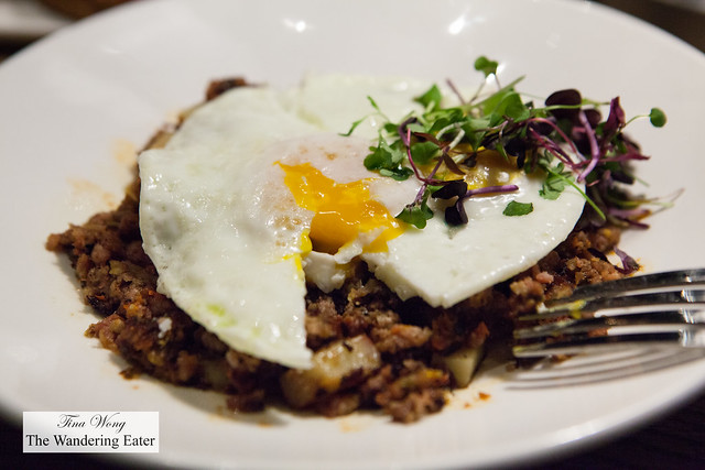 Pork pastrami hash with two eggs over easy