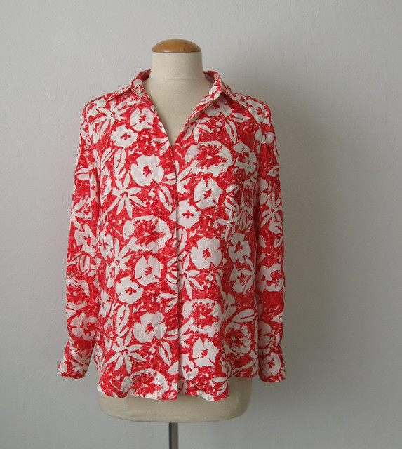 coral silk blouse on form