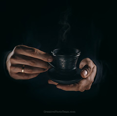 Man hands with cup of coffe close up image