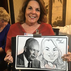 Carol  Cook got a #caricature next to  a copy of president Eisenhower today