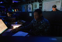 Operations Specialist 3rd Class Dontre Posey serves as the assistant battle watch captain in the Task Force 70 Tactical Flag Command Center during a joint Fleet Synthetic Training exercise. (U.S. Navy/MC3 Sara B. Sexton)