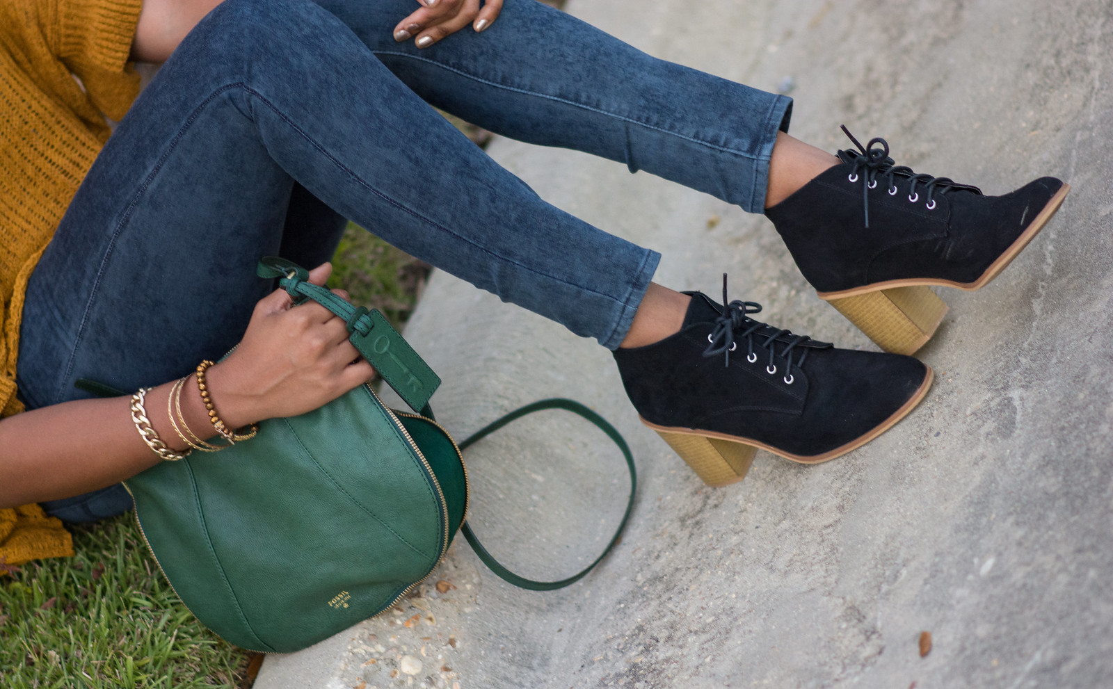 black suede booties green leather fossil handbag