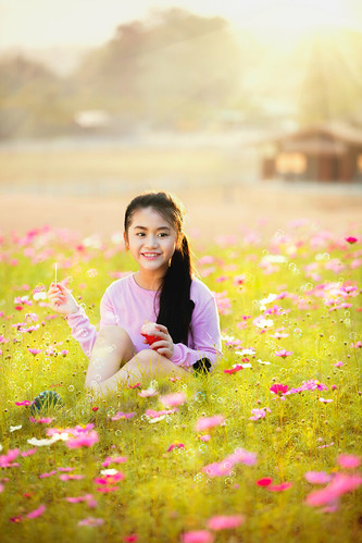 park light sunset summer portrait sun sunlight flower cute green nature girl beautiful beauty face field childhood female youth garden hair asian fun outdoors happy one freedom kid spring soap pretty child play little sweet background joy young meadow adorable lifestyle blowing blow bubble leisure concept playful cosmos
