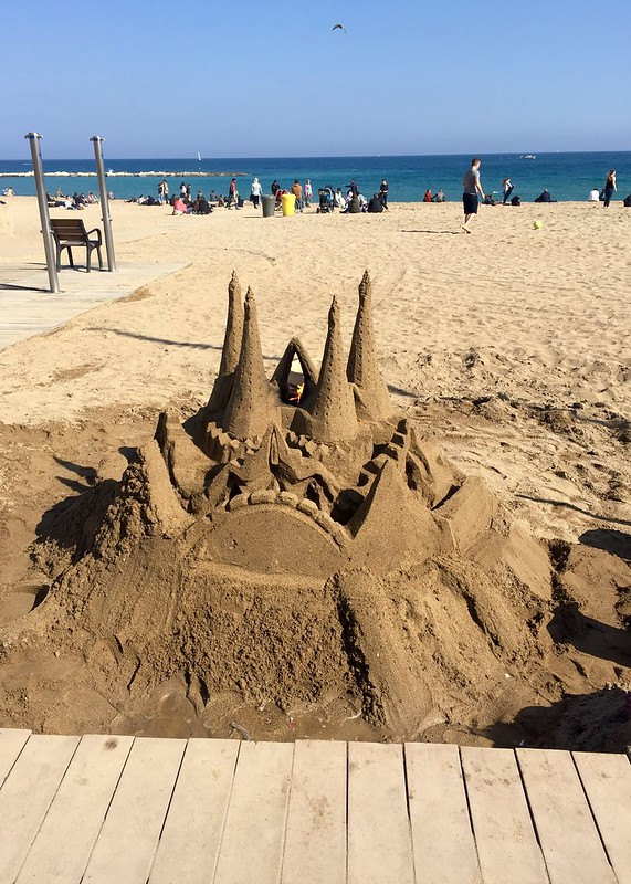 Impressive sandcastles! There's fire on the top!