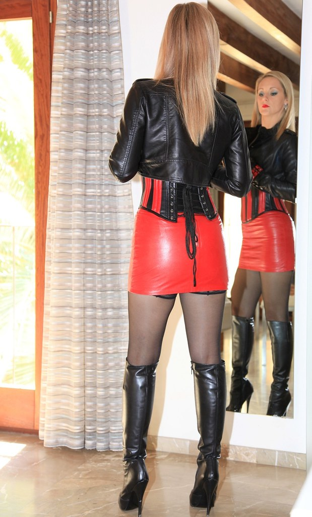 Hot Nordic blonde woman in red leather skirt and shinny Black ...