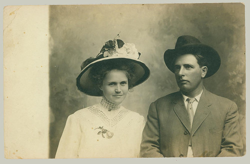 Woman and man with hats