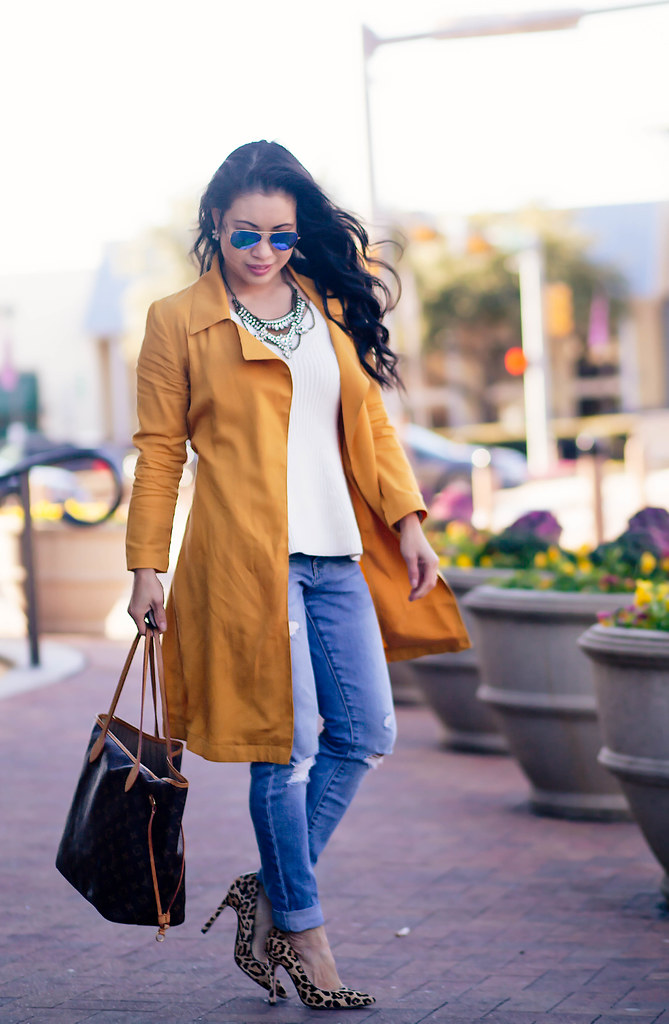 cute & little blog | mustard waterfall drape trench coat, white peplum knit sweater, distressed boyfriend jeans, leopard pumps, rayban blue mirror flash aviators, louis vuitton neverfull gm | spring outfit