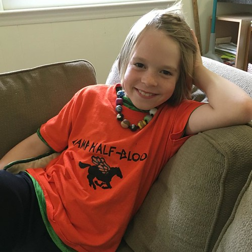 Still wearing his shirt and necklace from his friend Oskar's adorable Percy Jackson-themed sleepover last night. #camphalfblood