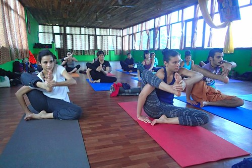 Our students getting into astavakrasana