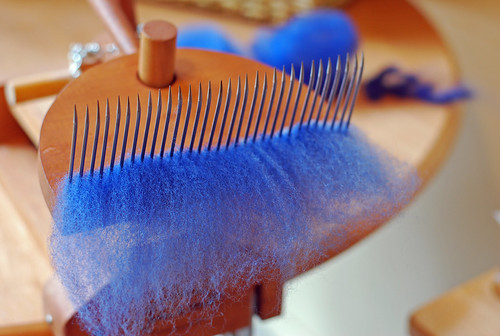 Hand preparing dyed Gulf Coast Native wool looks on Russian paddle combs by irieknit