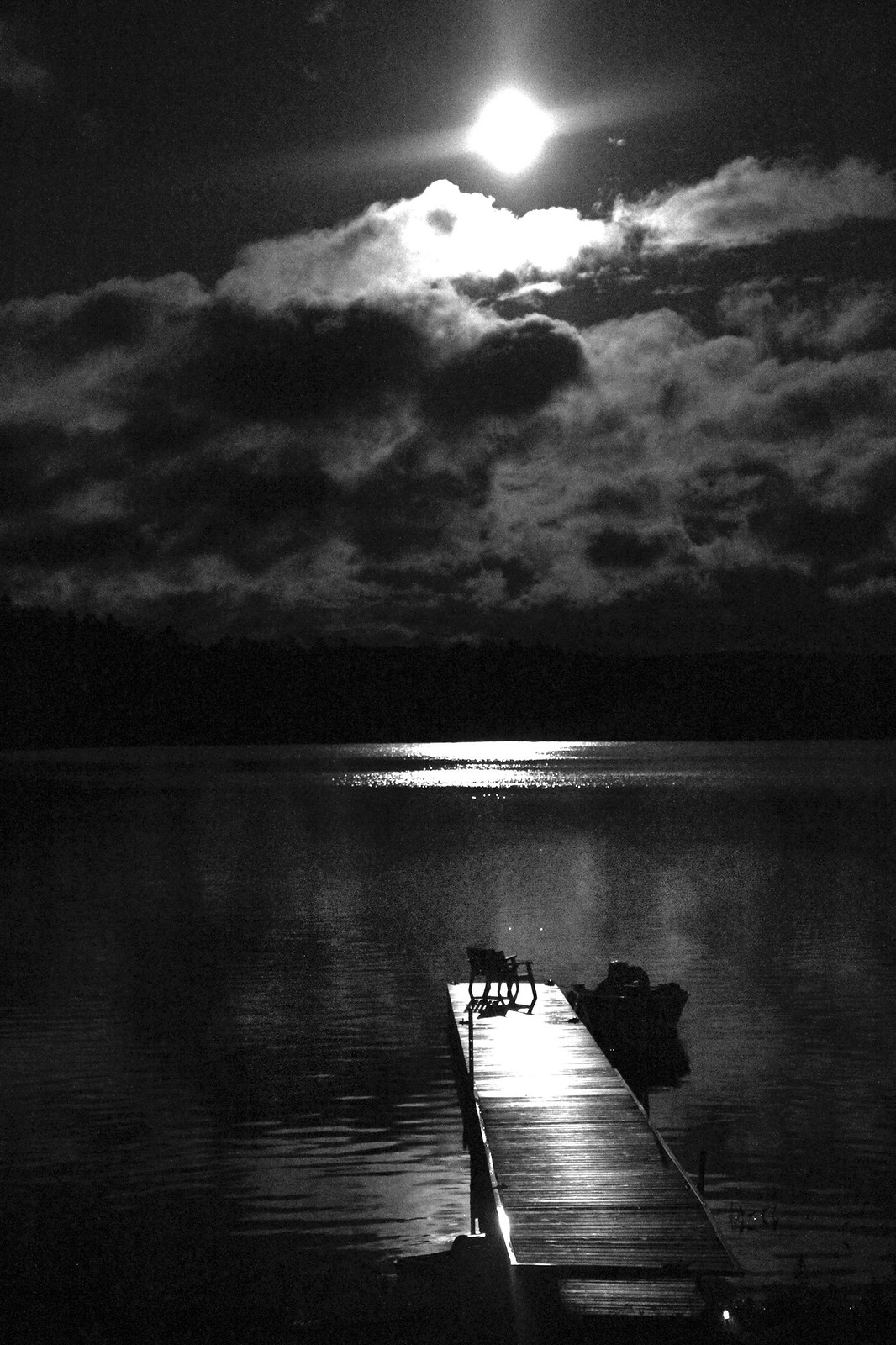 b:w hazy moon on dock