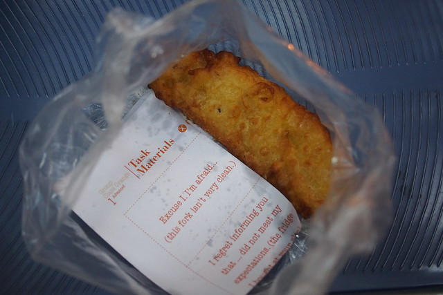 Dodgy English language notes. Banana fritters from Ben Thanh Market. Ho Chi Minh City (Saigon)