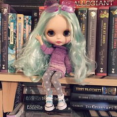 My first Blythe doll arrived today! Her name is Bowie and I'll take her out for a good photo session soon! She's marvelous. #blythe #bowie #doll #dollfashion #bookcase #books