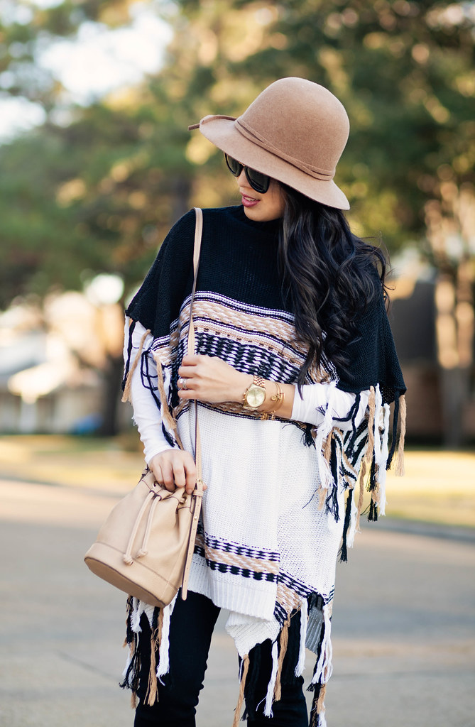 cute & little blog | petite fashion | free people labyrinth poncho, black jeans, taupe ankle boots, boho bucket bag, felt floppy hat | fall winter outfit