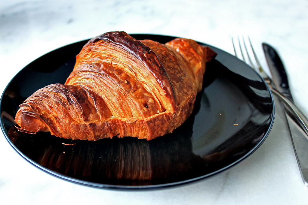 Black and Lnk Salted Egg Croissant with Fork