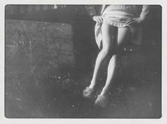 Closeup of a woman lifting her skirt
