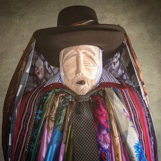 The Mayan God Moximon. This is not his real face. It is hidden under a mask and only the local brotherhood is allowed to see. He is smoking a cigar.
