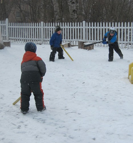 hockey with bats and a ball