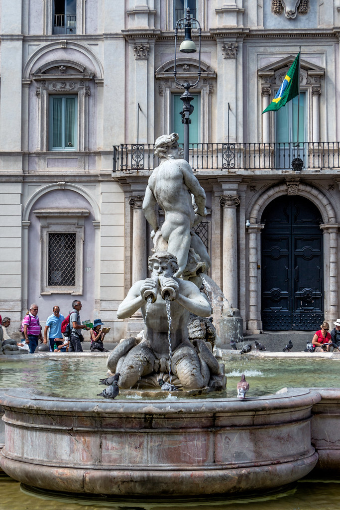 The fountain was originally designed by Giacomo della Porta in 1575 with the dolphin and four Tritons. In 1653, the statue of the Moor, by Gian Lorenzo Bernini, was added. In 1874, during a restoration of the fountain.